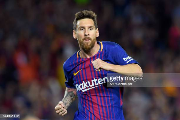 Barcelona's Argentinian forward Lionel Messi celebrates after scoring during the Spanish Liga football match Barcelona vs Espanyol at the Camp Nou...