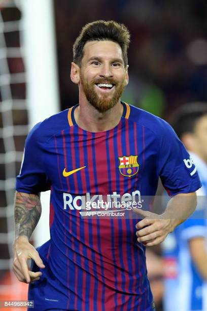 Barcelona's Argentinian forward Lionel Messi celebrates after scoring his second goal during the Spanish Liga football match Barcelona vs Espanyol at...