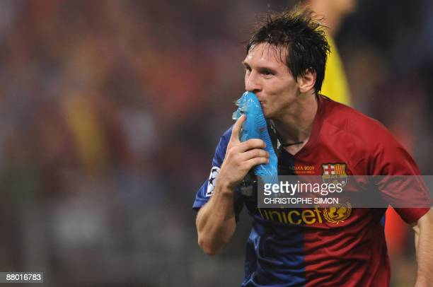 Barcelona´s Argentinian forward Lionel Messi celebrates after scoring against Manchester United during the final of the UEFA football Champions...