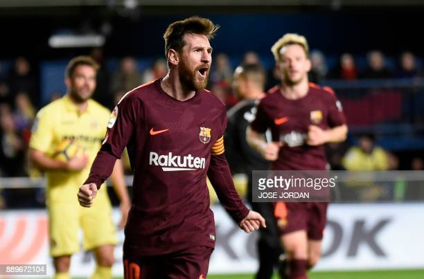Barcelona's Argentinian forward Lionel Messi celebrates after scoring during the Spanish league football match between Villarreal CF and FC Barcelona...