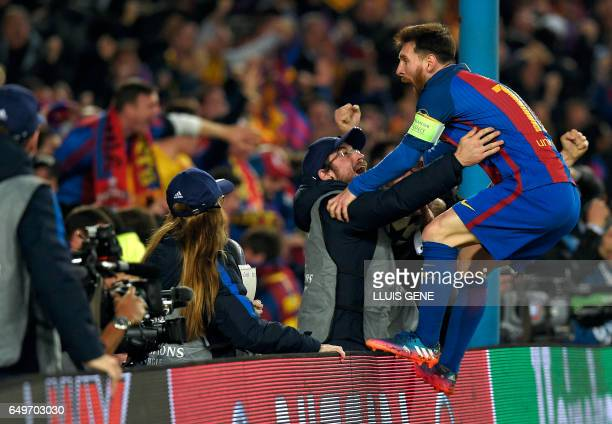 TOPSHOT Barcelona's Argentinian forward Lionel Messi celebrates Barcelona's midfielder Sergi Roberto's goal during the UEFA Champions League round of...
