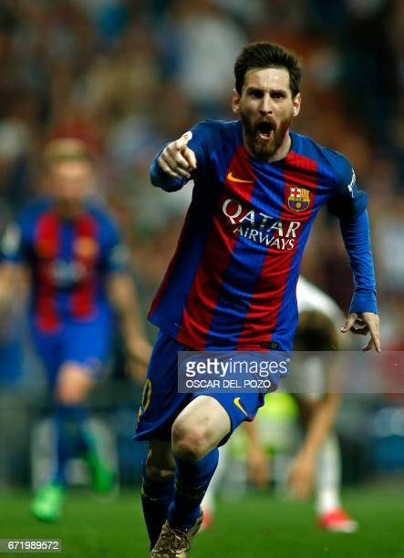 Barcelona's Argentinian forward Lionel Messi celebrates Barcelona's third goal during the Spanish league football match Real Madrid CF vs FC...