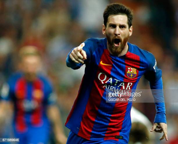 TOPSHOT Barcelona's Argentinian forward Lionel Messi celebrates Barcelona's third goal during the Spanish league football match Real Madrid CF vs FC...