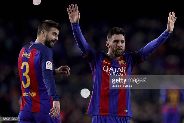 Barcelona's Argentinian forward Lionel Messi celebrates his goal beside Barcelona's defender Gerard Pique during the Spanish league football match FC...