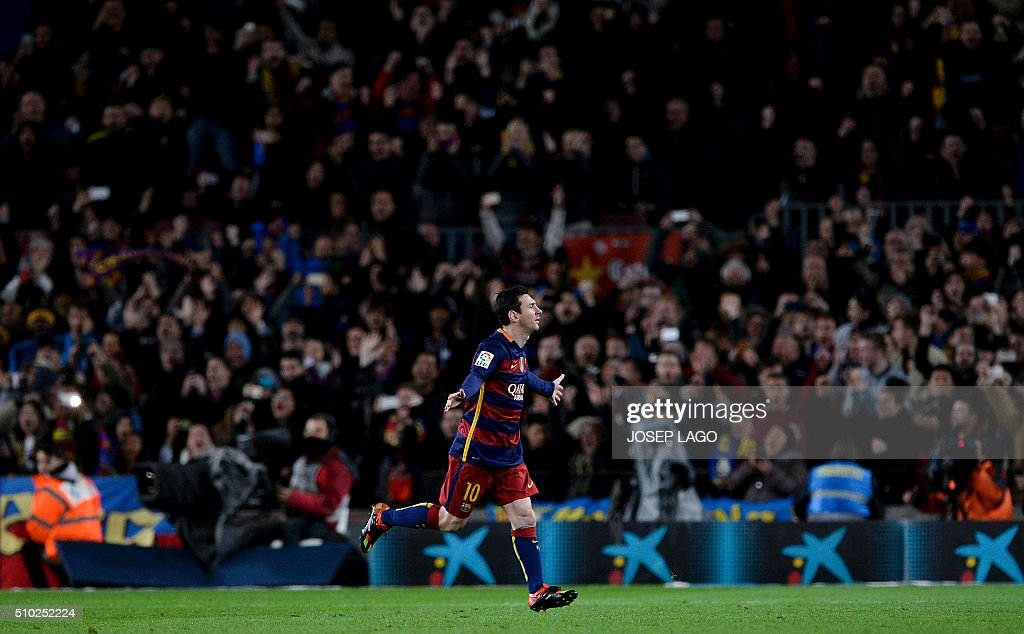 Barcelona's Argentinian forward Lionel Messi celebrates his goal during the Spanish league football match FC Barcelona vs RC Celta de Vigo at the Camp Nou stadium in Barcelona on February 14, 2016. LAGO