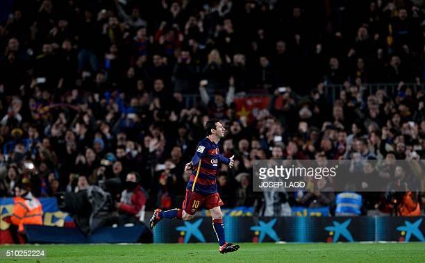 Barcelona's Argentinian forward Lionel Messi celebrates his goal during the Spanish league football match FC Barcelona vs RC Celta de Vigo at the...
