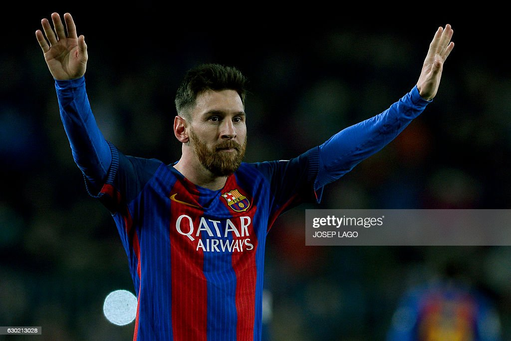 Barcelona's Argentinian forward Lionel Messi celebrates his goal during the Spanish league football match FC Barcelona vs RCD Espanyol at the Camp Nou stadium in Barcelona on December 18, 2016. / AFP / JOSEP
