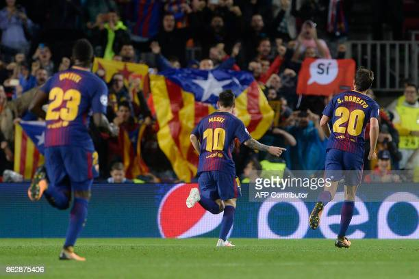 Barcelona's Argentinian forward Lionel Messi celebrates his goal during the UEFA Champions League Group D football match between FC Barcelona vs...