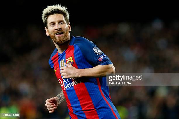 Barcelona's Argentinian forward Lionel Messi celebrates his second goal during the UEFA Champions League football match FC Barcelona vs Manchester...