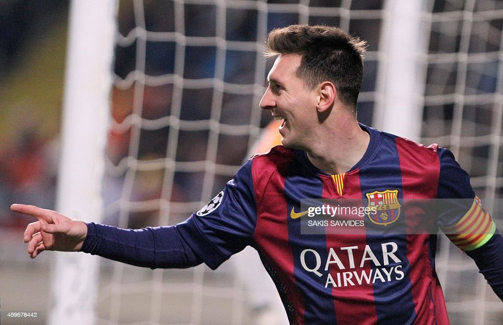 Barcelona's Argentinian forward Lionel Messi celebrates scoring a goal during their UEFA Champions League football match against Apeol at the Neo GSP...