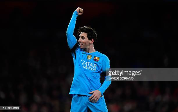 Barcelona's Argentinian forward Lionel Messi celebrates scoring his team's second goal from the penalty spot during the UEFA Champions League round...