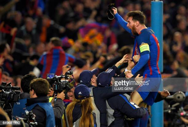 TOPSHOT Barcelona's Argentinian forward Lionel Messi celebrates their victory at the end of the UEFA Champions League round of 16 second leg football...