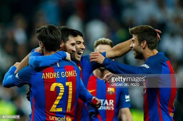 Barcelona's Argentinian forward Lionel Messi celebrates with Barcelona's defender Gerard Pique and teammates after scoring during the Spanish league...
