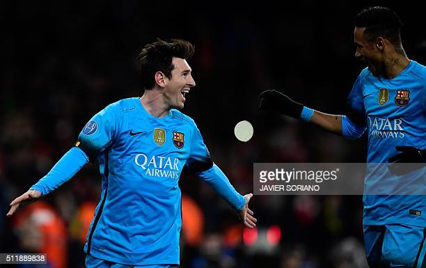 Barcelona's Argentinian forward Lionel Messi celebrates with Barcelona's Brazilian forward Neymar celebrates scoring his team's second goal from the...