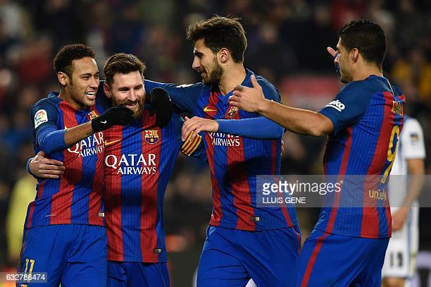 TOPSHOT Barcelona's Argentinian forward Lionel Messi celebrates with Barcelona's Brazilian forward Neymar Barcelona's Portuguese midfielder Andre...