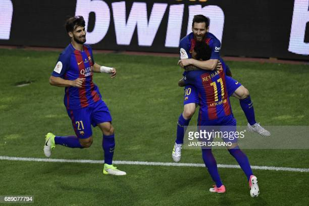 Barcelona's Argentinian forward Lionel Messi celebrates with Barcelona's Brazilian forward Neymar and Barcelona's Portuguese midfielder Andre Gomes...