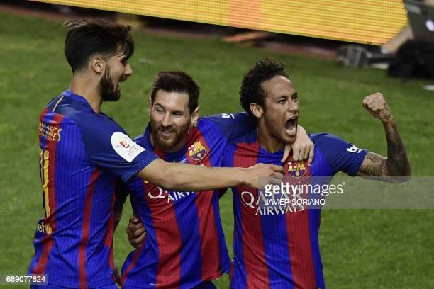 Barcelona's Argentinian forward Lionel Messi celebrates with Barcelona's Brazilian forward Neymar and Barcelona's Portuguese midfielder Andre Gomes...