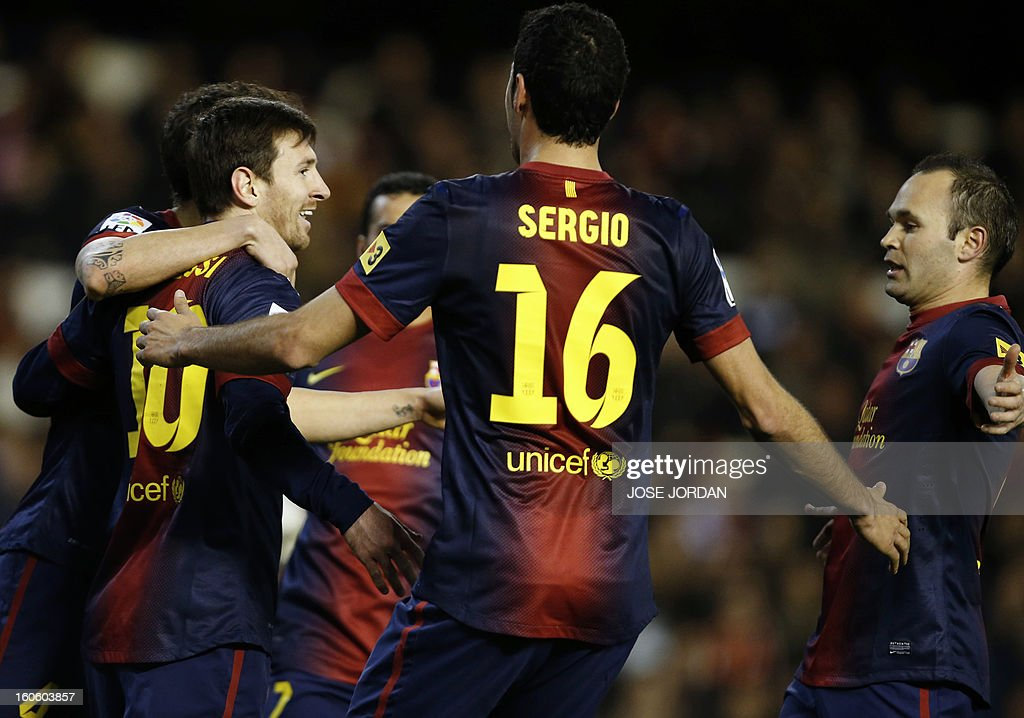 Barcelona's Argentinian forward Lionel Messi (L) celebrates with his teammates after scoring during the Spanish league football match Valencia CF vs FC Barcelona at the Mestalla stadium in Valencia on February 3, 2013 . AFP PHOTO / JOSE JORDAN