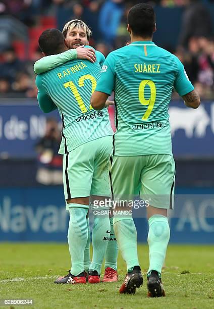 Barcelona's Argentinian forward Lionel Messi celebrates with Barcelona's midfielder Rafael Alcantara during the Spanish league football match CA...