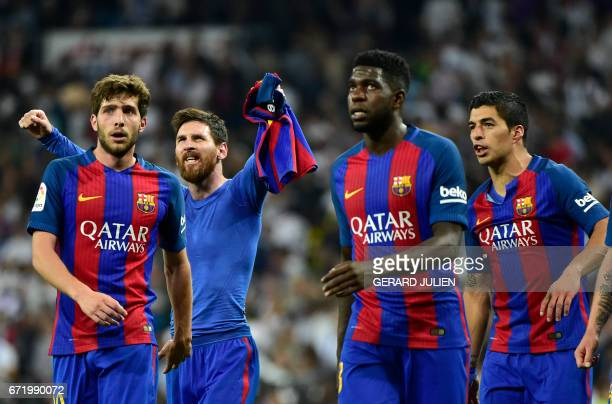 Barcelona's Argentinian forward Lionel Messi celebrates with Barcelona's midfielder Sergi Roberto Barcelona's French defender Samuel Umiti and...