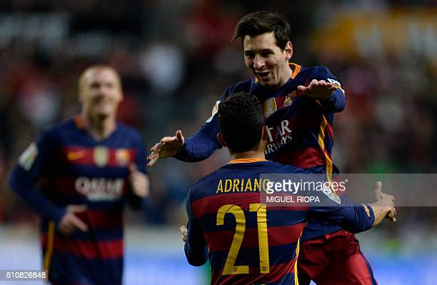 Barcelona's Argentinian forward Lionel Messi celebrates with teammate Brazilian defender Adriano after scoring a goal during the Spanish league...