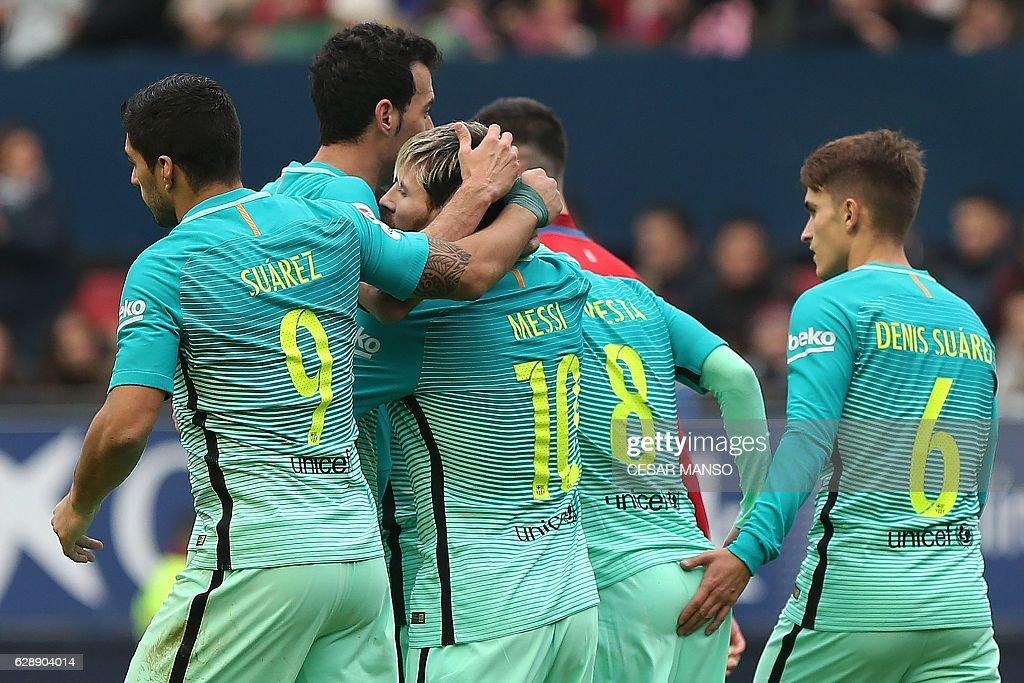 Barcelona's Argentinian forward Lionel Messi (3L) celebrates with teammates during the Spanish league football match CA Osasuna vs FC Barcelona at the Reyno de Navarra (El Sadar) stadium in Pamplona on December 10, 2016. / AFP / CESAR