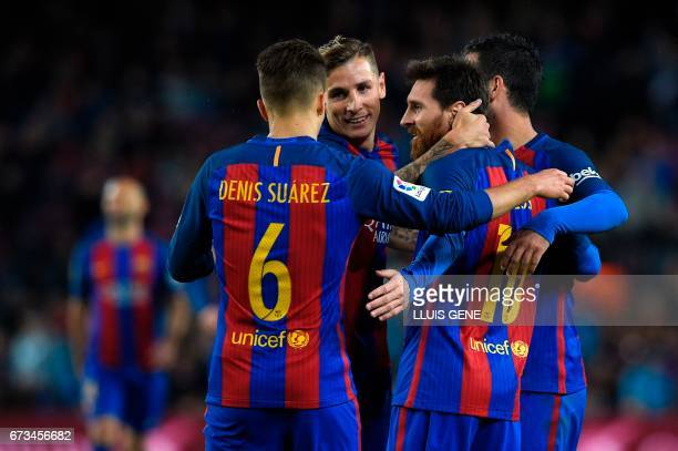 Barcelona's Argentinian forward Lionel Messi celebrates with teammates after scoring a goal during the Spanish league football match FC Barcelona vs...