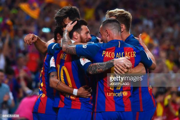 TOPSHOT Barcelona's Argentinian forward Lionel Messi celebrates with teammates after scoring the opener during the Spanish Copa del Rey final...
