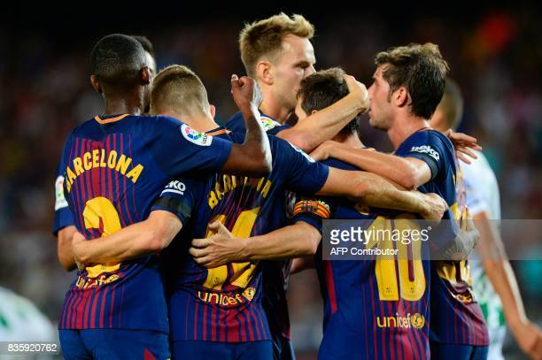 Barcelona's Argentinian forward Lionel Messi celebrates with teammates after scoring during the Spanish league footbal match FC Barcelona vs Real...