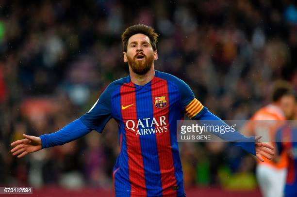 Barcelona's Argentinian forward Lionel Messi clebrates after scoring a goal during the Spanish league football match FC Barcelona vs CA Osasuna at...