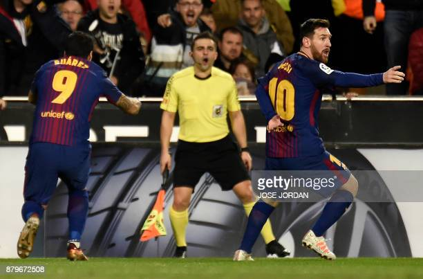 TOPSHOT Barcelona's Argentinian forward Lionel Messi complains during the Spanish league football match Valencia CF and FC Barcelona at Mestalla...
