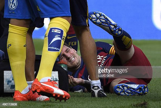 Barcelona's Argentinian forward Lionel Messi complains on the field during the Spanish league football match FC Barcelona vs UD Las Palmas at the...