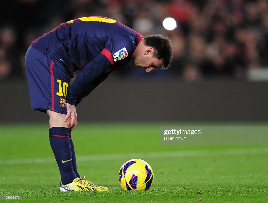 Barcelona's Argentinian forward Lionel Messi concentrates prior to a penalty kick during the Spanish league football match FC Barcelona vs RCD Espanyol at the Camp Nou stadium in Barcelona on January 6, 2013.