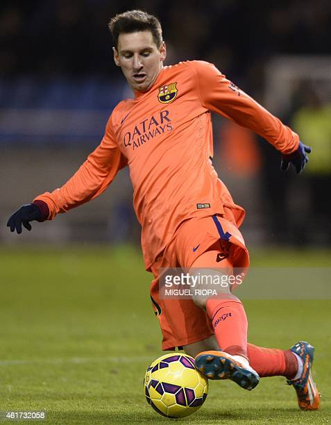 Barcelona's Argentinian forward Lionel Messi controls the ball during the Spanish league football match RC Deportivo de la Coruna vs FC Barcelona at...