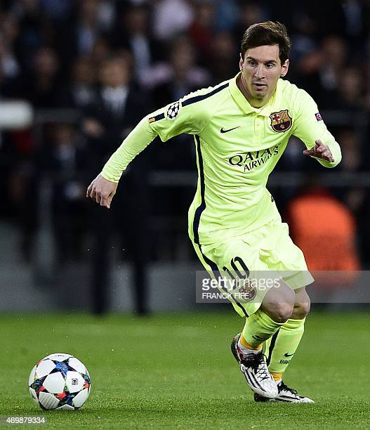 Barcelona's Argentinian forward Lionel Messi controls the ball during the UEFA Champions league quarterfinal first leg football match PSG vs FC...