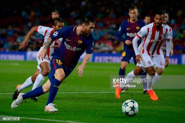 Barcelona's Argentinian forward Lionel Messi controls the ball during the UEFA Champions League group D football match FC Barcelona vs Olympiacos FC...