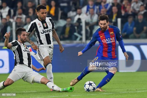 Barcelona's Argentinian forward Lionel Messi fights for the ball with Juventus midfielder Miralem Pjanic and Juventus Defender from Brazil Dani Alves...