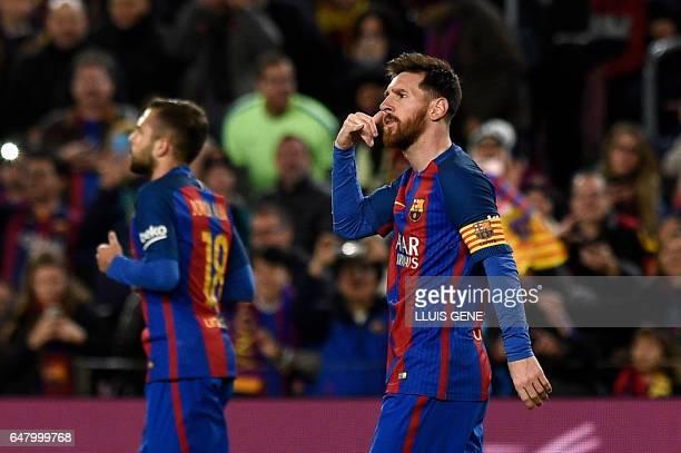 Barcelona's Argentinian forward Lionel Messi gestures after scoring a goal during the Spanish league football match FC Barcelona vs RC Celta de Vigo...