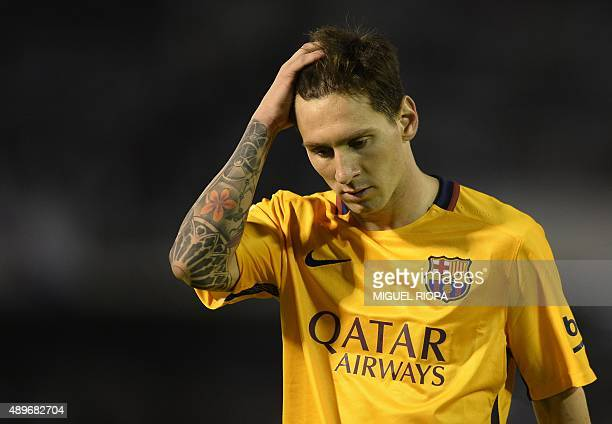 Barcelona's Argentinian forward Lionel Messi gestures at the end of the Spanish league football match Celta Vigo vs FC Barcelona at the Balaidos...
