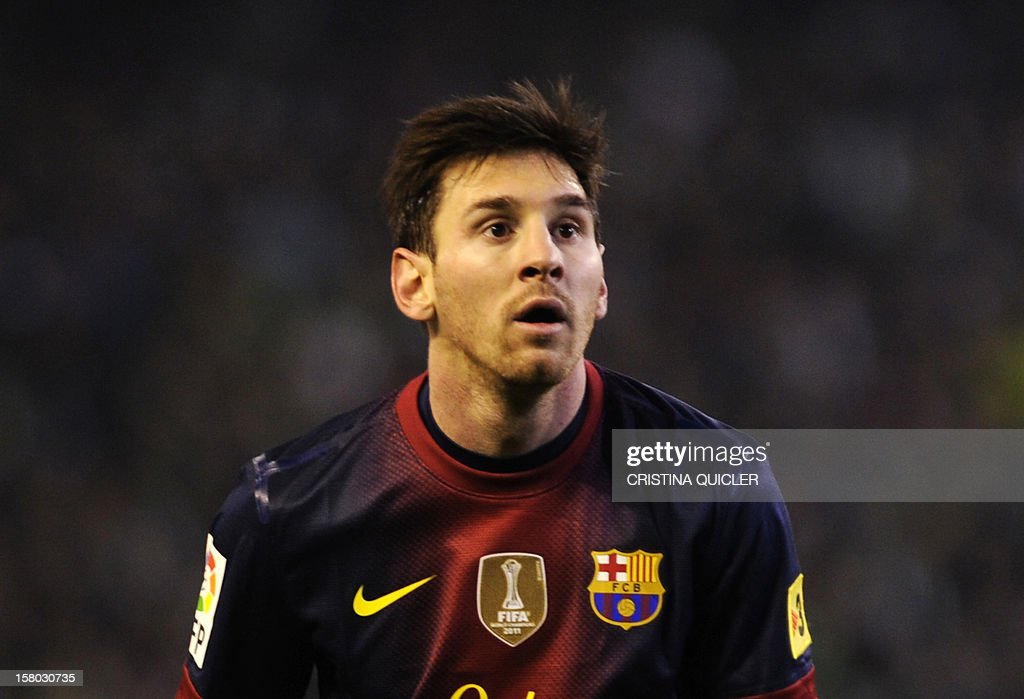 Barcelona's Argentinian forward Lionel Messi gestures during the Spanish league football match Real Betis vs Barcelona at the Benito Villamarin stadium in Sevilla on December 9, 2012.AFP PHOTO/ CRISTINA QUICLER