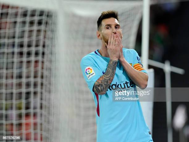 Barcelona's Argentinian forward Lionel Messi gestures during the Spanish league football match Athletic Club Bilbao vs FC Barcelona at the San Mames...