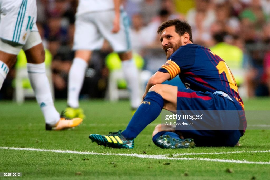 Barcelona's Argentinian forward Lionel Messi grimaces as he sits on the ground during the second leg of the Spanish Supercup football match Real Madrid vs FC Barcelona at the Santiago Bernabeu stadium in Madrid, on August 16, 2017. /