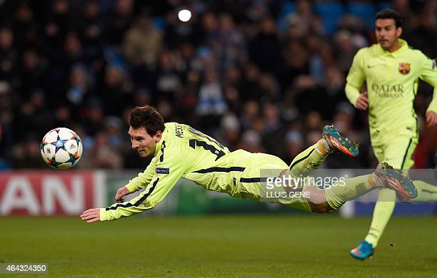 Barcelona's Argentinian forward Lionel Messi heads the ball wide off the rebound from his penalty that was saved by Manchester City's English...