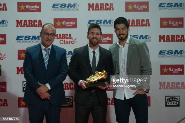 Barcelona's Argentinian forward Lionel Messi his teammate Barcelona's Uruguayan forward Luis Suarez and Juan Ignacio Gallardo Marca newspaper...