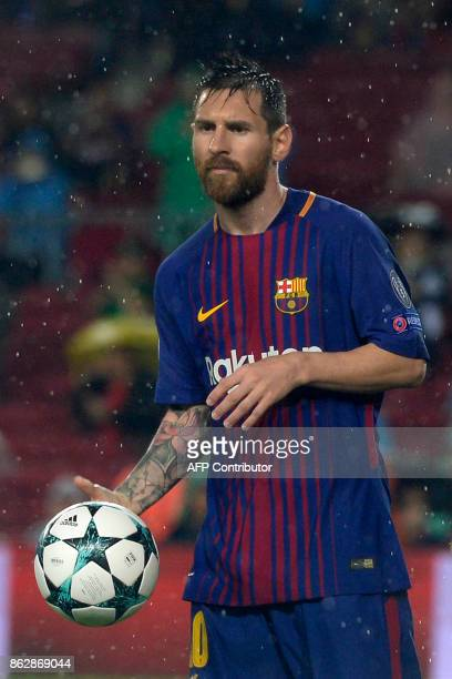Barcelona's Argentinian forward Lionel Messi holds the ball during the UEFA Champions League group D football match FC Barcelona vs Olympiacos FC at...