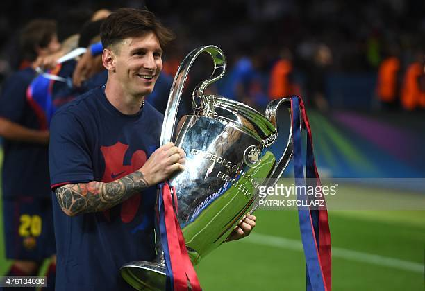 Barcelona's Argentinian forward Lionel Messi holds the trophy after the UEFA Champions League Final football match between Juventus and FC Barcelona...