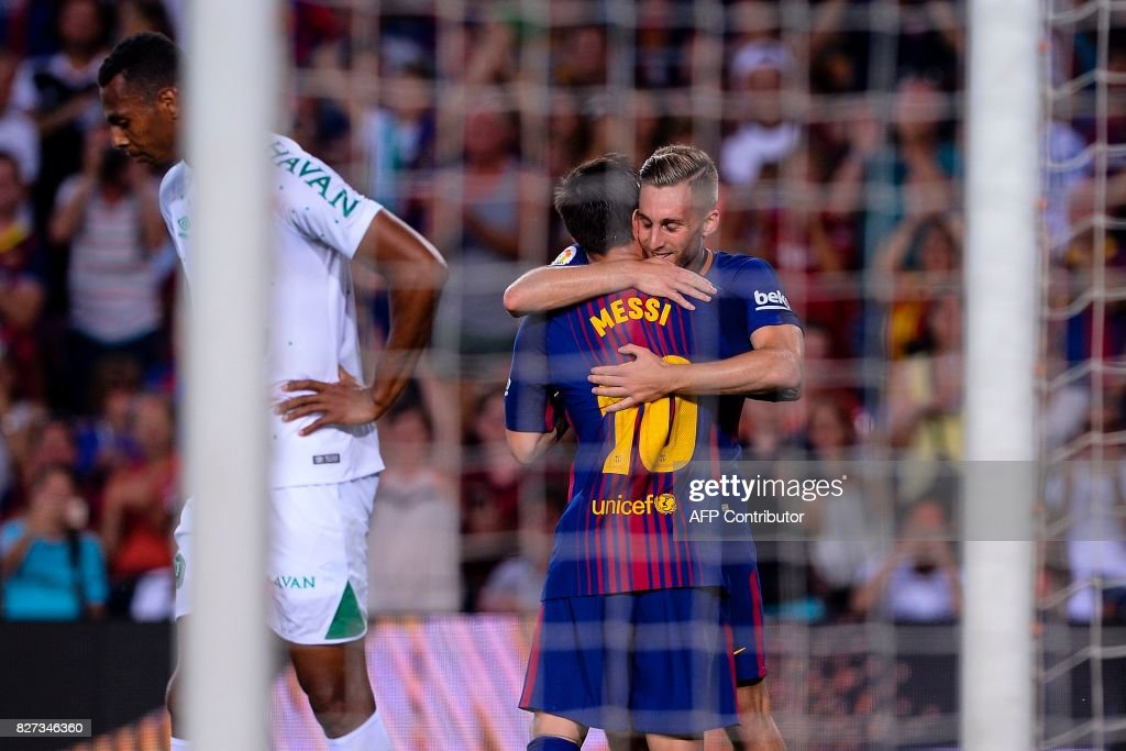 Barcelona's Argentinian forward Lionel Messi (L) is congratulated by teammate Barcelona's forward Gerard Deulofeu (R) after scoring a goal during the 52nd Joan Gamper Trophy friendly football match between Barcelona FC and Chapecoense at the Camp Nou stadium in Barcelona on August 7, 2017. Funds raised from the match will 'help Chapecoense rebuild institutionally and recover the competitive level it had before the tragedy', Barca said in a statement as the Brazilian side still reeling from a devastating plane crash that killed 19 players and 24 club officials last year. / AFP PHOTO / Josep LAGO