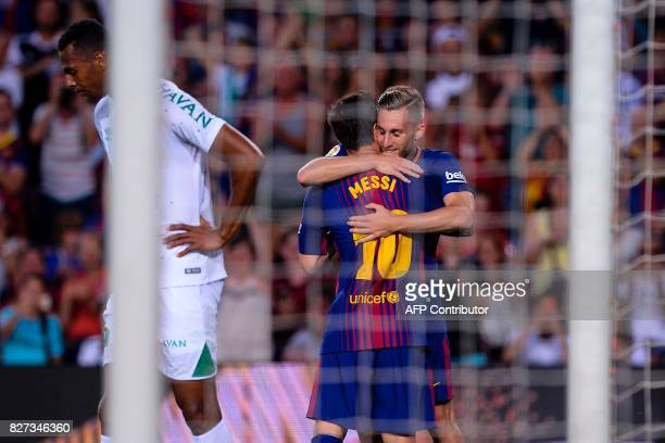 Barcelona's Argentinian forward Lionel Messi is congratulated by teammate Barcelona's forward Gerard Deulofeu after scoring a goal during the 52nd...