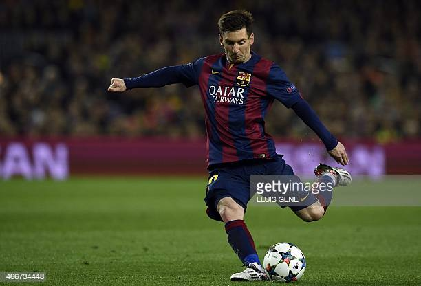 Barcelona's Argentinian forward Lionel Messi kicks a ball during the UEFA Champions League round of 16 football match FC Barcelona vs Manchester City...