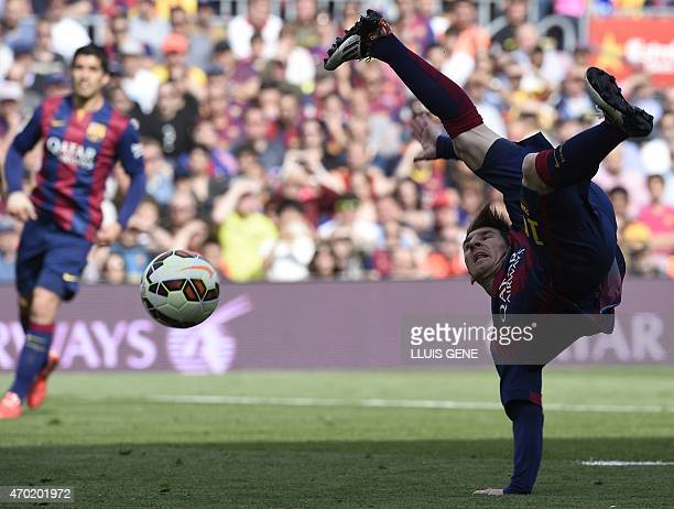 Barcelona's Argentinian forward Lionel Messi kicks a ball during the Spanish league football match FC Barcelona v Valencia CF at the Camp Nou stadium...